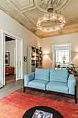 Open-plan living room with stucco ceiling in Wilhelmine-era villa