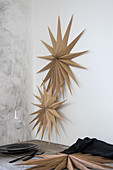 Christmas stars made from wood veneer decorating wall