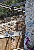 Sink in outdoor kitchen of Italian stone house