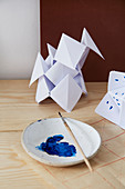 Paper ornaments with blue paint