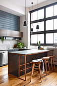 Masculine kitchen with industrial window and kitchen counter