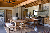 Wooden furniture in rustic kitchen-dining room