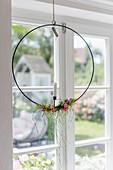 Nordic flower wreath hung in window