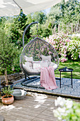 Summer terrace with hanging chair