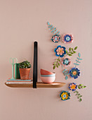 Arrangement of handmade paper flowers on wall