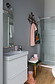 Pale grey bathroom with pink accents