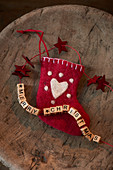 Christmas stocking and festive greeting made from wooden letters