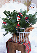 Christmas arrangement in metal basket
