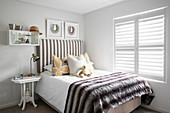 Bed with striped headboard in classic child's bedroom