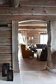 Open doorway leading into adjacent room in modern log cabin