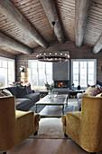 Open fireplace in living room of modern log cabin
