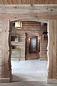 Traditional open doorway leading into hallway of log cabin