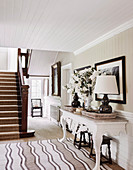 Hallway area with nostalgic white two-legged console table