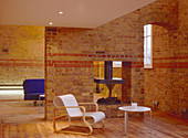 Living room in old building with brick walls