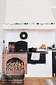 Antique wood-burning stove in country-house kitchen