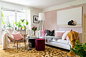 Glamorous, feminine living room in shades of pink and ochre