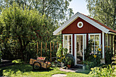 Falu-red, Scandinavian-style summerhouse in summer garden