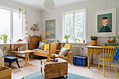 Bright nursery with patterned wallpaper and wooden furniture