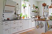 Island counter in white kitchen