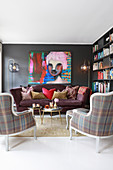 Sofa, tartan armchairs and huge portrait of woman in eclectic living room