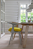 Dining area in white-painted log cabin