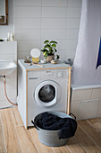 Washing machine in DIY wooden cabinet