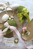 Moss eggs with ribbons and gold Easter decorations