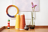 Multicoloured decorative ring made from knitted tubes made using knitting dolly