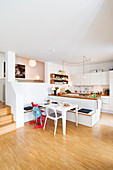 Dining area with DIY corner bench made from kitchen wall cabinets and worksurface