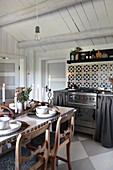 Dining table in rustic kitchen with chequered floor