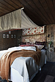 Canopy over comfortable bed in rustic bedroom