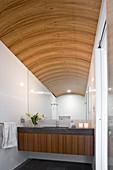 Elegant bathroom with vaulted ceiling