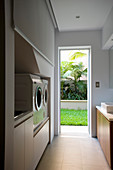 Utility room with open door leading into garden