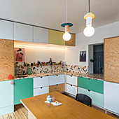 Kitchen with multicoloured fronts and terrazzo worksurface