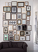 Gallery of framed photos, drawings and text decorating wall