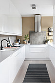 White, U-shaped, fitted galley kitchen