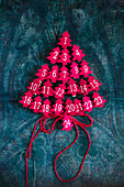 Small, numbered, felt trees arranged in the shape of a Christmas tree