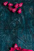 Small, numbered, felt trees arranged on paisley cloth