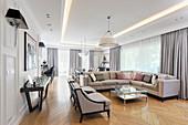 Sofa combination in elegant interior with herringbone parquet floor