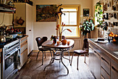 Fifties-style breakfast table and two chairs in kitchen