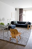 Designer chair on grey rug in classic living room