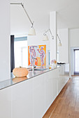 White, minimalist kitchen island used as partition