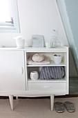 White sideboard in bedroom