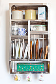 Vintage accessories on stainless steel kitchen shelving