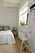 Bedroom in white with wooden floors and shabby chic style