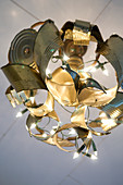 Homemade ceiling lamp made from cut open cans