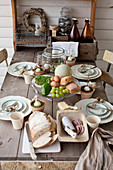 Rustic, wooden, country-house table set for Easter breakfast