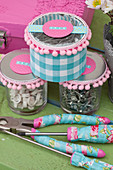 Jars decorated in feminine style and tools with floral decoupage