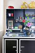 Black case kitchen with colourful accessories