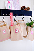 Numbered paper bags covered with masking tape as an advent calendar